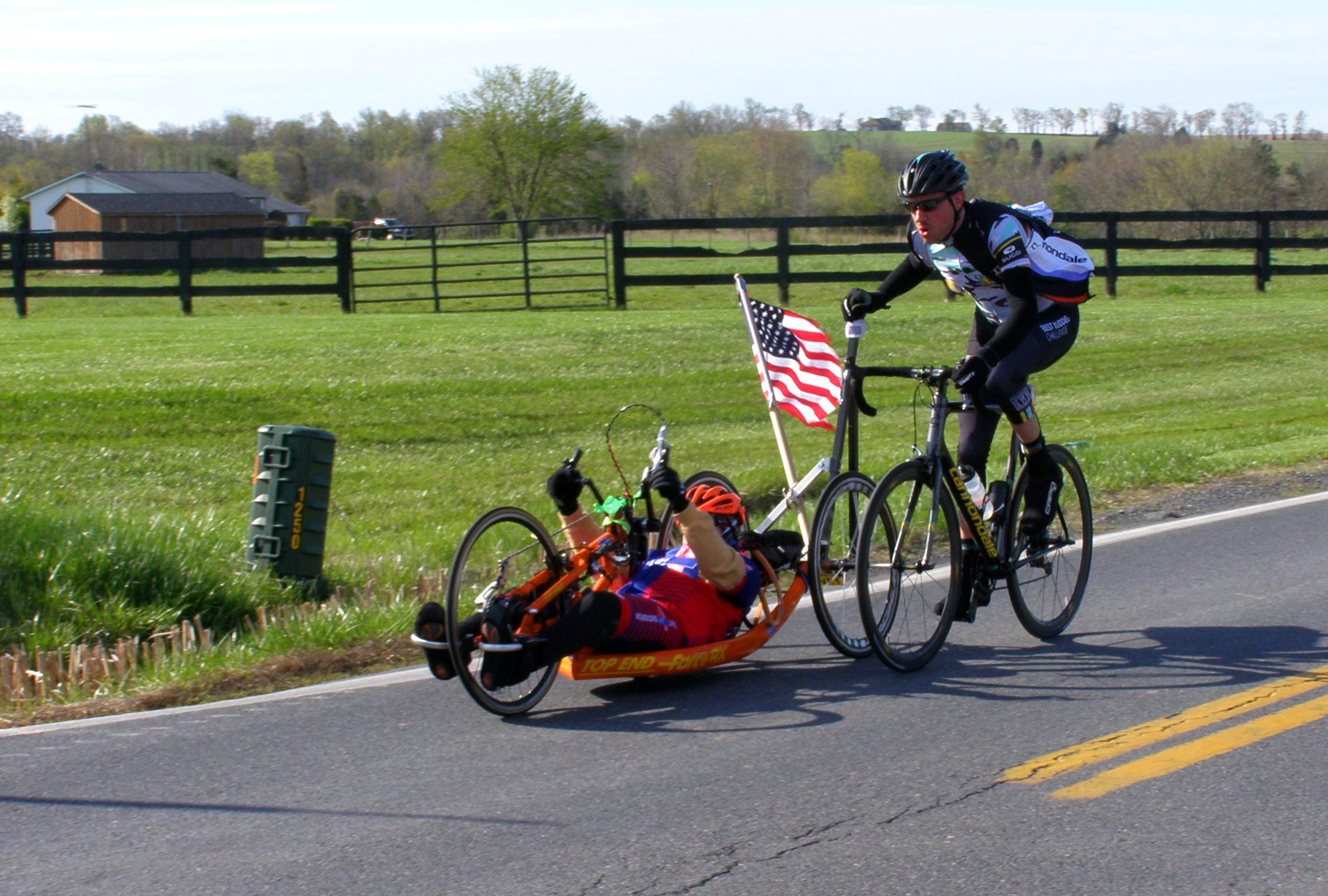 An able-bodied rider provides assistance in 2015.