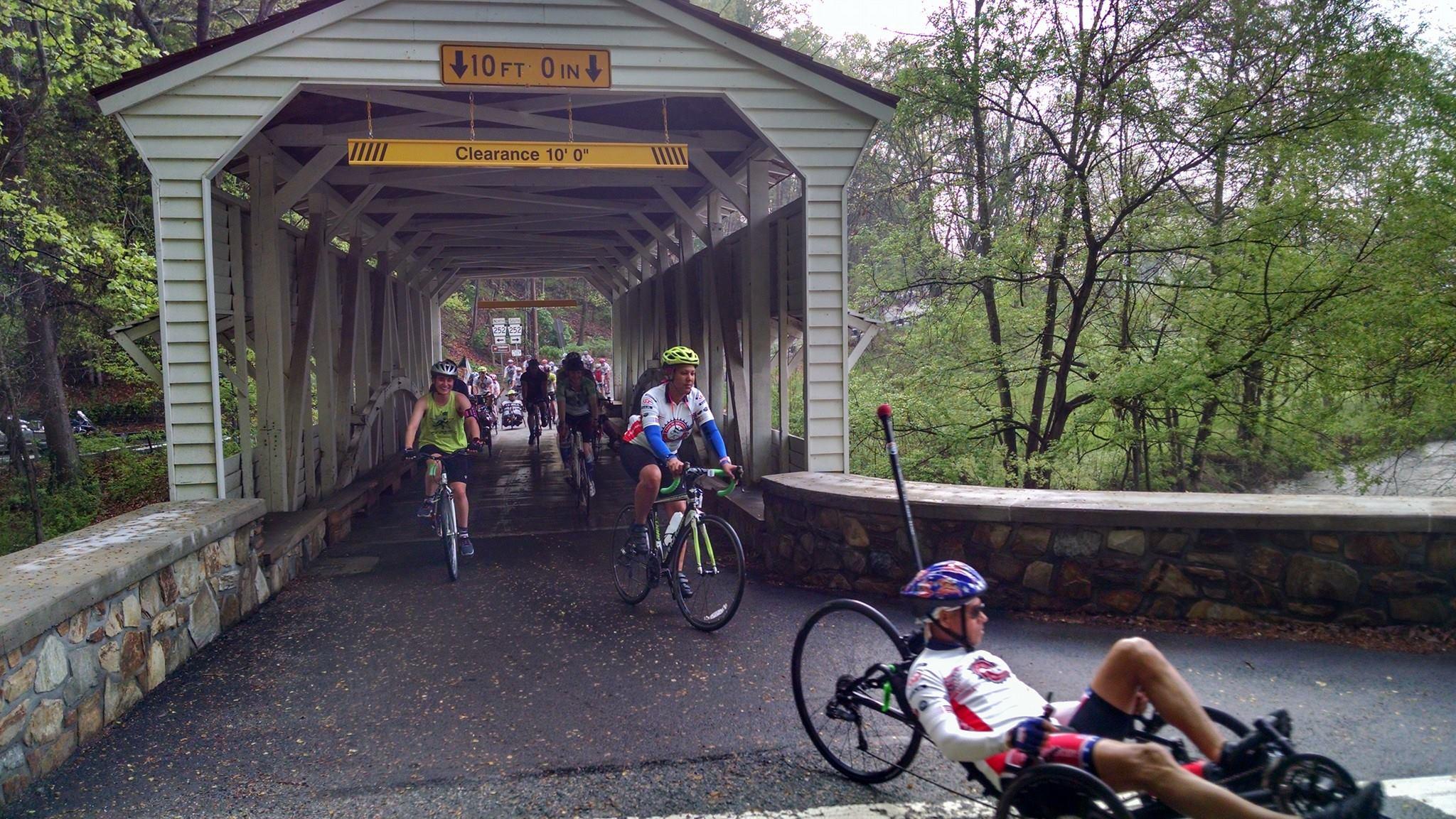 Riders pass through Knox Covered Bridge