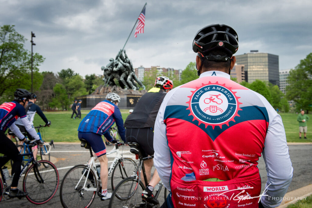 Riders pass the United States Marine Corps War Memorial in Virginia.