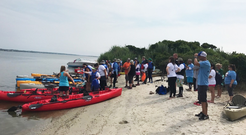 Kayaks wait on the beach for the Challenge start
