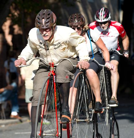 Larry Black on his high wheel bicycle