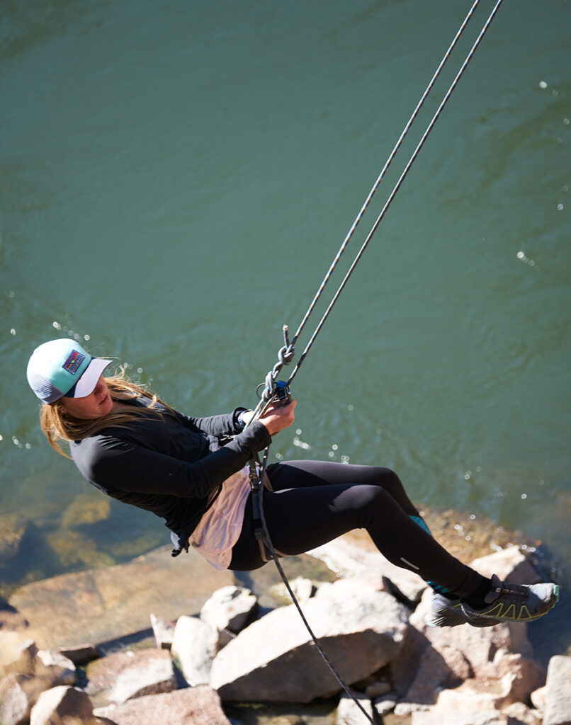 Rappelling off a granite cliff.