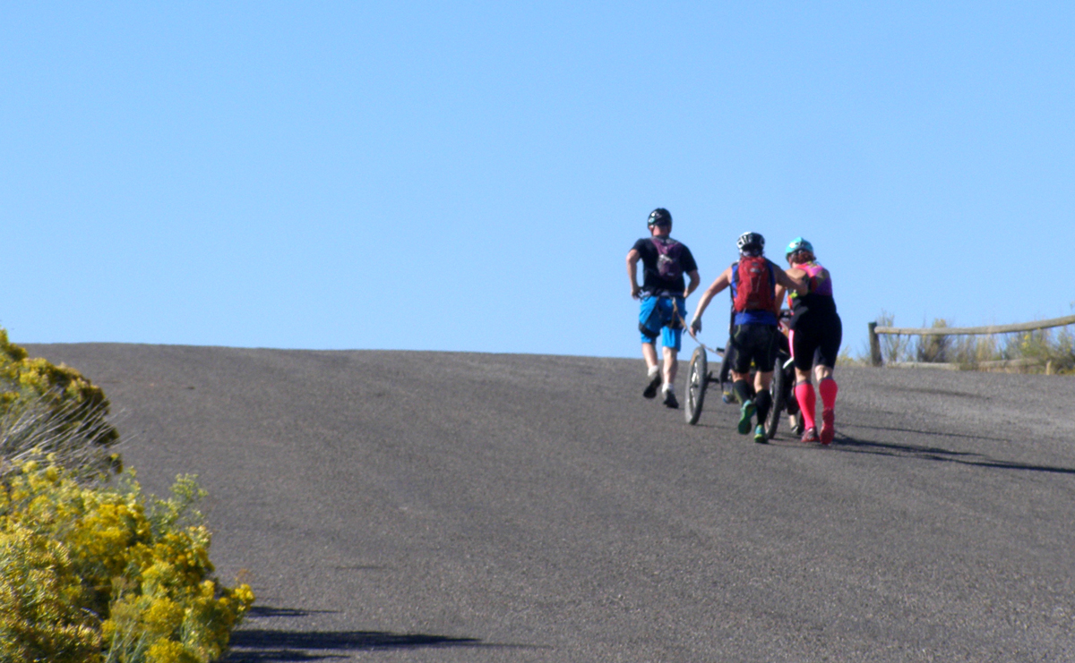 Climbing a steep hill on foot and hand cycle.